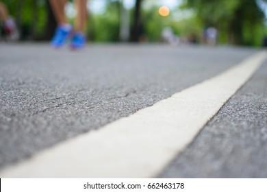 blur Athlete runner feet running on road