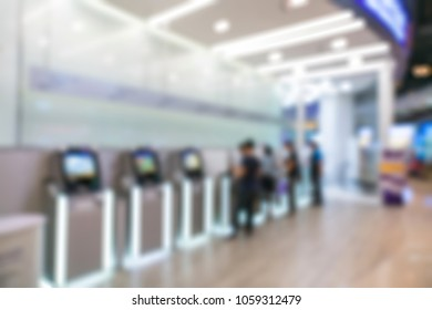 Blur ATM Customers and bank tellers inside an bank.
