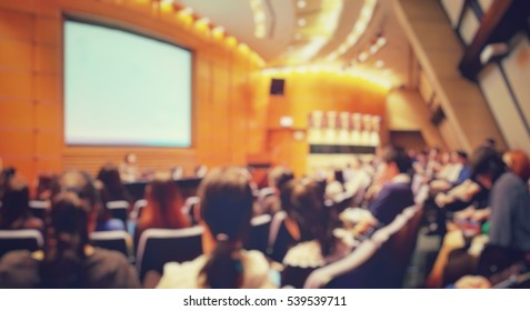 Blur of auditorium room use for present meeting background