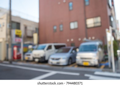 Blur of automatic car parking system in Tokyo Japan for background usage