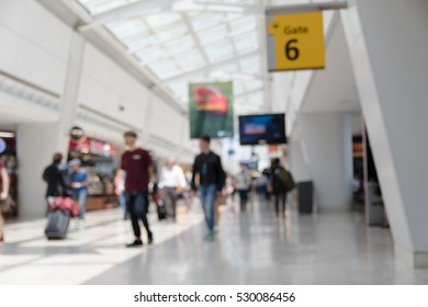 Blur background. Airport scene. People walking out of  focus. Busy