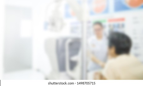 Blur background Asia old woman with cabinet ophthalmic eye examination in ophthalmology clinic doing eye exam test after cataract operation.Save Your Vision Month
