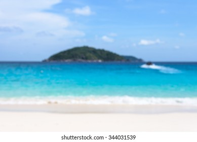 Blur for background beautiful landscapes blue sea beach island and the return journey by boat of tourists under sky in summer at Miang island, Mu Ko Similan National Park, Phang Nga, Thailand