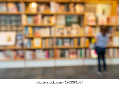 Blur background of book shelf store decorated with wood and warm light