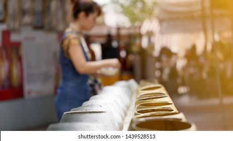 Blur background of Buddhist merit making on Buddhist Lent Day, Buddhist merit making by giving alms to Buddhist important days, Buddha's Day.