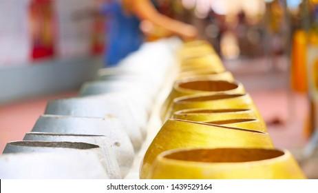 Blur background of Buddhist merit making on Buddhist Lent Day, Buddhist merit making by giving alms to Buddhist important days.