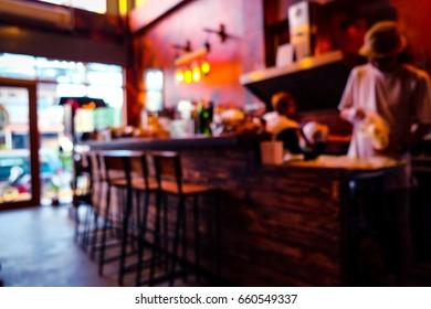 Blur background of burger & pizza cafe bar.