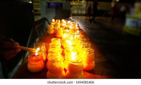 Blur background of candle lighting for blessings on Buddhist Lent Day and Buddha's day, Buddhist merit making on Buddhist Lent Day.