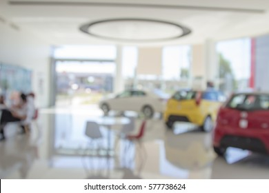 Blur the background of the car and Showroom at blurred in workplace or abstract background of shallow office depth of focus.