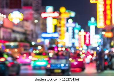 Blur background of Cars and shops on Yaowarat road. Chinatown with notable Chinese buildings, restaurants and decoration. Busy Yaowarat Road in the evening. chinese new year. travel thailand concept