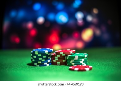 Blur background and chips, Stack of poker chips on a green table. Poker game theme