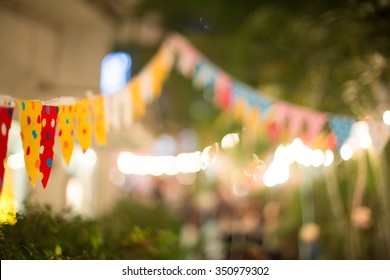 Blur background colorful triangular flags of decorated celebrate outdoor party, vintage tone.