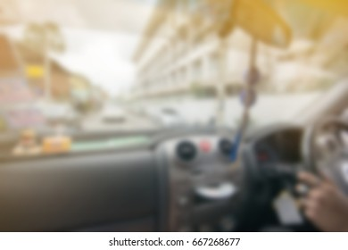 blur background of console car on people drive street