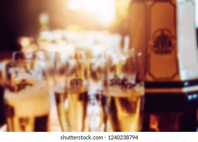 Blur background of delicious tasty fresh homemade handcraft brew, ipl, ale, cider, hob, yeast, craft beverage beer glass drink in restaurant pub bar cafe  and testing during factory visit in German