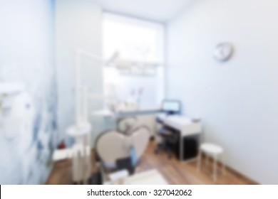 Blur background of dentist's office. Dental equipment, modern interior