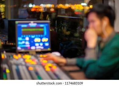 Blur background engineer control switcher in studio news.