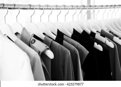 Blur background of fashion woman clothes hanging on rack