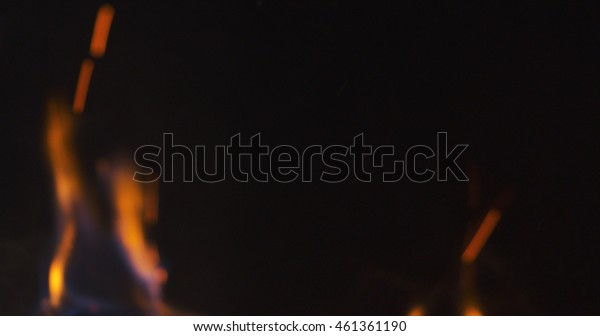 blur background of flames in fireplace