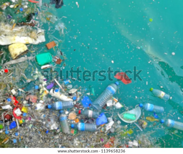 Blur background of garbage patch pollution in ocean