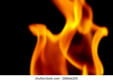 Blur Background Image of the Flames from a Torch at Night