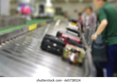 Blur Background Image of Passengers Waiting for Suitcase at Baggage Carousel, China Beijing Capital Airport, June 2017