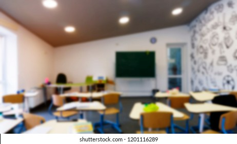 Blur background image. School class with school desks and green blackboard. Concept: back to school