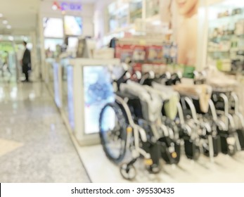 Blur background inside pharmacy store with shelves of medical supplies stretcher and wheelchair