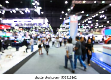 blur background of international motorshow, Bangkok , Thailand. car show room. Abstract blurred image people in international  cars exhibition show in geneva.
