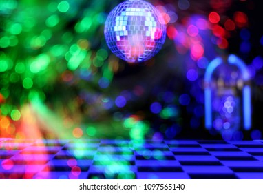 Blur Background Jukebox in Bar with Disco Ball and Colorful Lights
