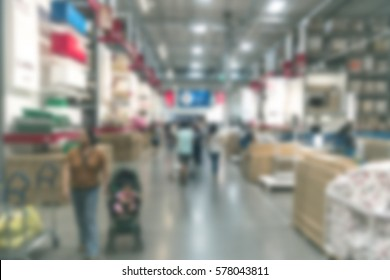 Blur background large indoor warehouse with high racks and products store on it for supply chain procurement operation logistic process e-commerce distribution omi channel b2b, b2c value chain concept