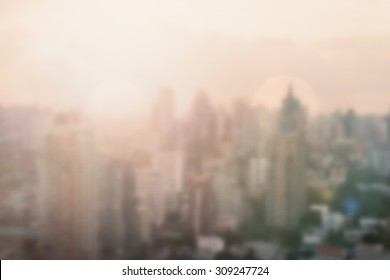 Blur background of morning light rooftop view of downtown Bangkok with sun flare and bokeh in vintage color