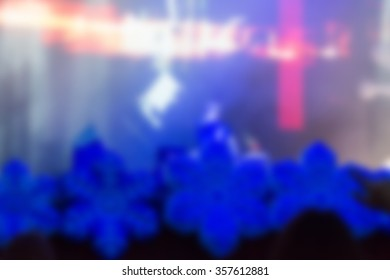 Blur background of people hanging out at the concert