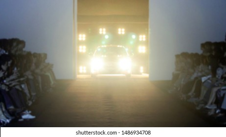 Blur background of runway for new model car,opening event out of focus