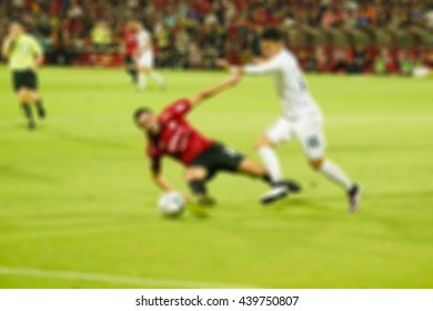 Blur background of Soccer players in action on the sunset stadium background,vintage color,for display