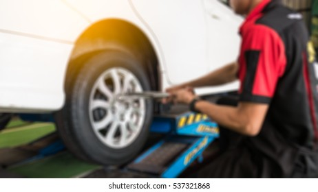 blur background of  technician installing the wheels