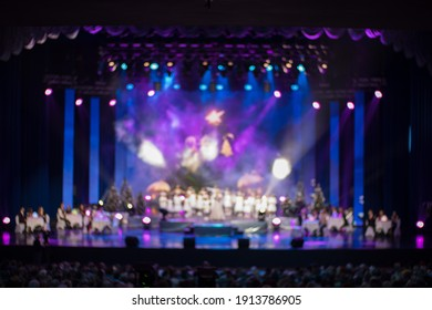 blur background, texture for design. Spotlights in the concert hall and screen on the background.