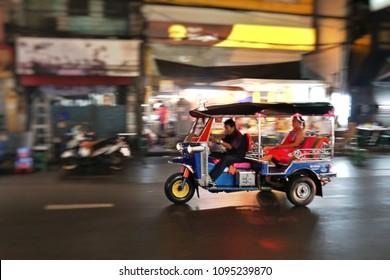 Blur background of Tuk-Tuk on Yaowarat road,the main street of Chinatown in Bangkok.Tuk-Tuk is the name of Thai traditional taxi.Chinatown is famous landmark in Bangkok.