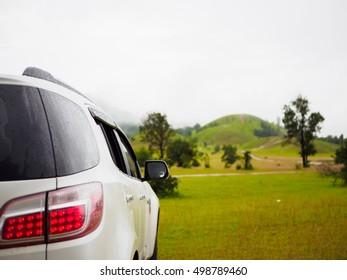 blur background white car at Phu Khao Ya (grass hill) Ranong, Thailand