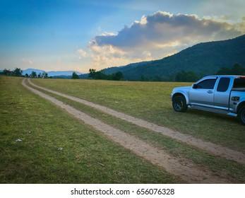 blur background white car at Phu Khao Ya (grass hill) Ranong, Thailand.
