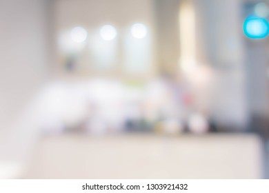 Blur background,Modern kitchen counter top with housewares appliances and bokeh light.