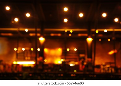 blur bar or pub at dark night background abstract