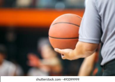 Blur Basketballs in referee's hand.