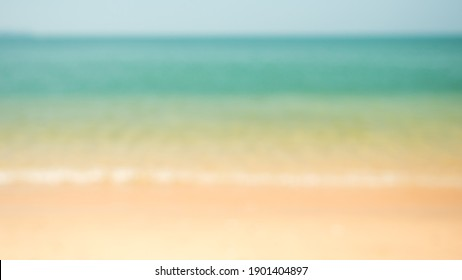 Blur beautiful nature tropical beach with bokeh sun light wave abstract background. Copy space of summer vacation and Summer holiday concept.