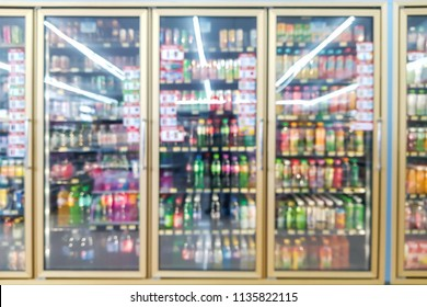 The blur of the beverage refrigerator in the convenience store.