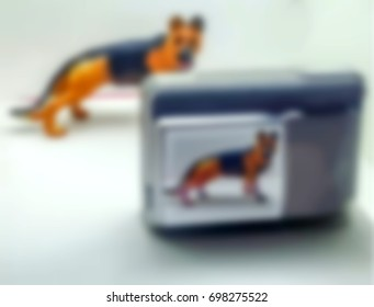 Blur blonde camera to photograph a white background dog with a shallow abstrak camera distance mobile photography