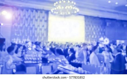 blur blue waiter on gala dinner service in hotel ballroom