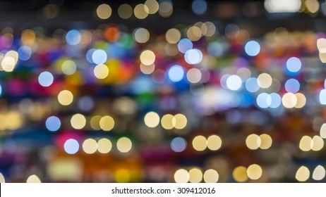 blur bokeh background of multicolour lights of Bangkok night market