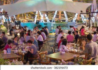blur and bokeh family dinner at restaurant
