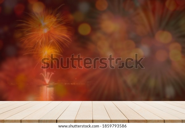 Blur bokeh, firework with blank wood table. for merry christmas and happy new year 2021.