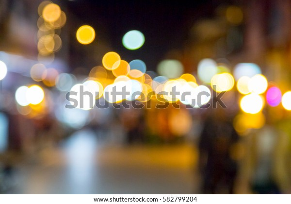 Blur with bokeh of night market at the city background